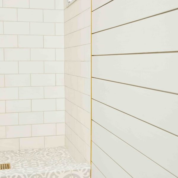 gold accent shower tile South Shore project by Cabinet Plant